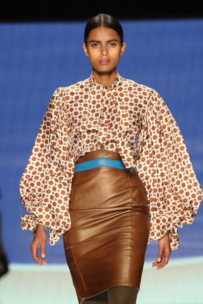Printed blouson-sleeved shirt and leather skirt (Lakshmi, India)