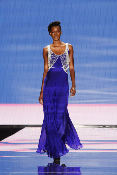 Royal blue silk gown with strands of freshwater pearls
