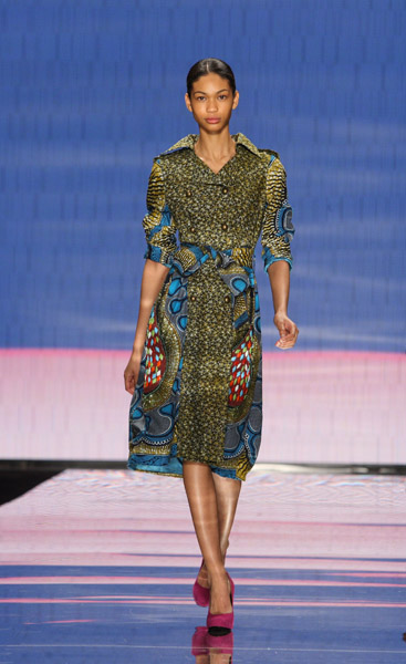 Chanel Iman in handbeaded Ankara trench with belt