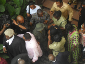 Ibinabo protected by family and friends as she leaves the courtroom. Photo: Odunayo Abiodun