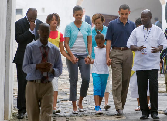 Mrs. O in cropped pants, a white tee and a blue cardigan as the Obamas toured symbolic sites
