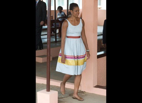 Michelle O in a dress by Sophie Theallet during a hospital visit in Ghana