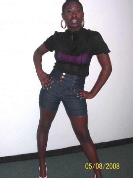 Sheer Victorian blouse: Charolette Russe; High waist shorts: Dots; Gold hoops
