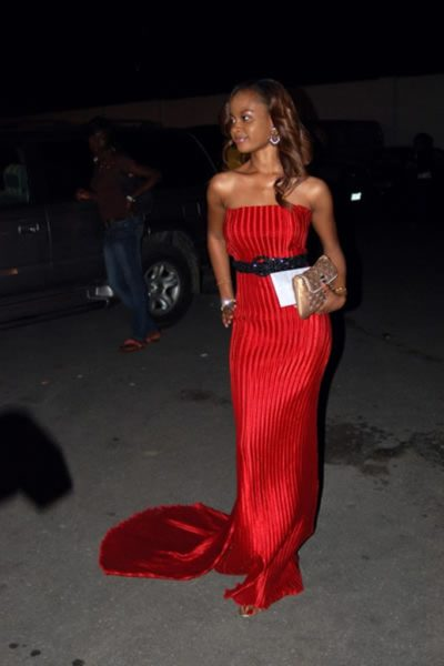 Omowunmi in a Red train gown at a fashion Show