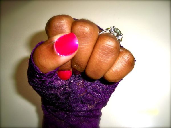 I love bright pink or red polish. Fingerless gloves and engagement ring.