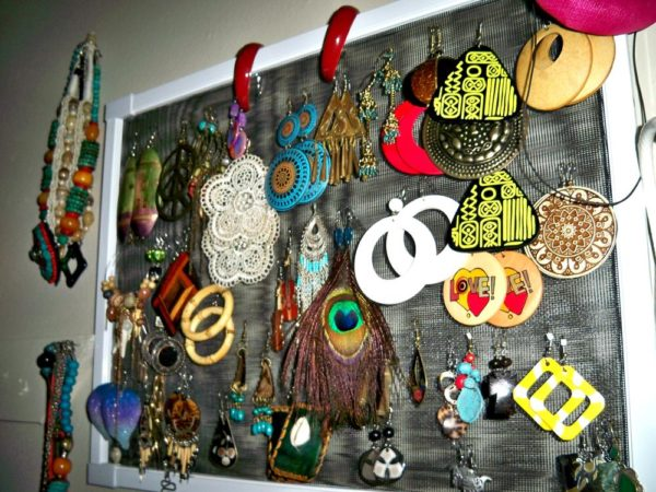 Part of my earring collection; violins, doilies, cowries, etc :D