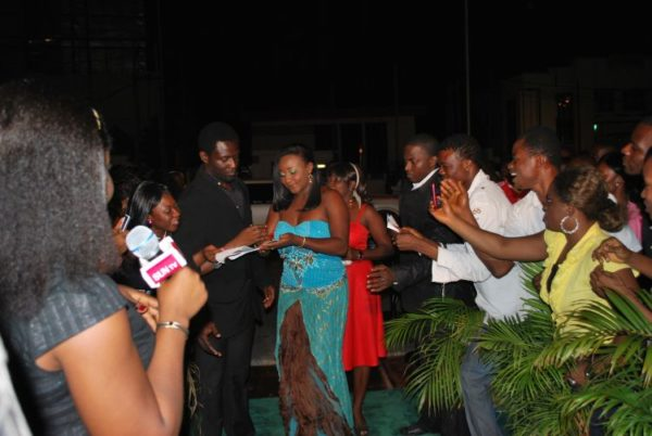 Ini Edo (playing herself) on the set of Nollywood Hustler