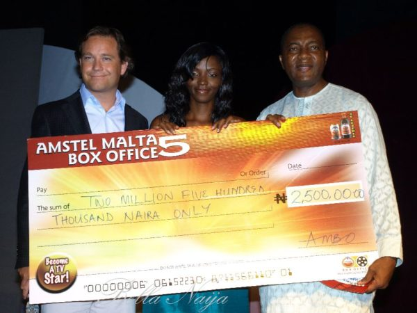 The winner - Ivie - receives her symbolic 2.5 million cheque