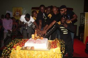 Compere, Andre Blaze, Xfellaz alongside Banky W cutting the Malta Guinness Valentine Cake