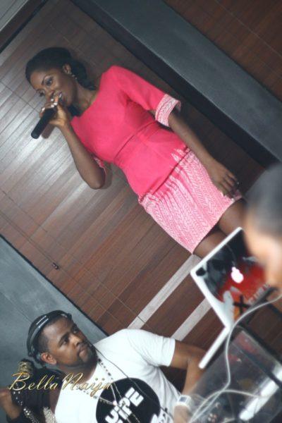 Birthday girl Tiwa on the mic