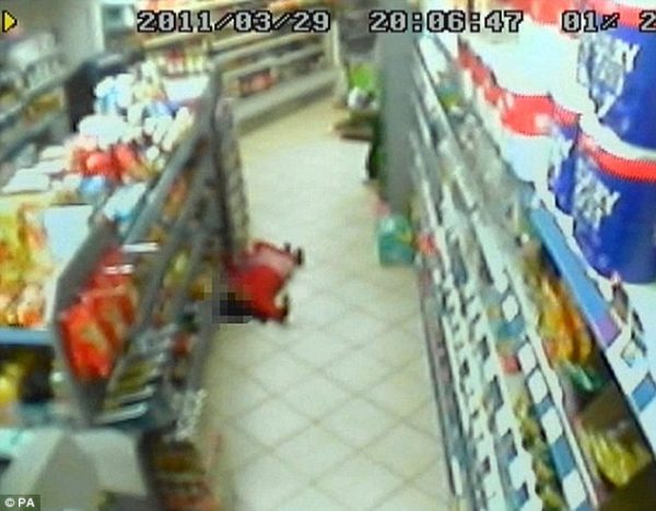 CCTV still showing Thusha lying on the floor having being shot in the chest