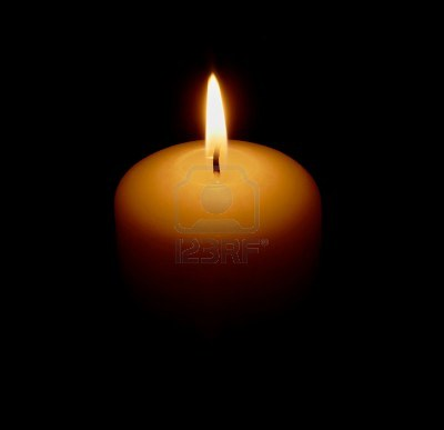 11082997-the-burning-candle-on-a-black-background