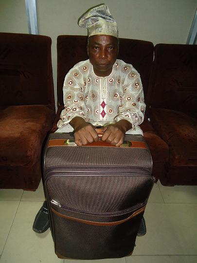 Fatoke Abiodun with his Suitcase