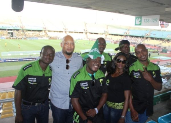 Plato Syrimis(Etisalat Director of Customer Care) (second left) and Etisalat customers at the Royal Bafokeng Stadium before the Nigeria v Ethiopia match