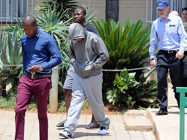 Oscar Pistorius leaves the Boschkop police station, east of Pretoria, South Africa, on Feb. 14, 2013, en route to appear in court