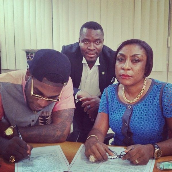 Burna-Boy-his-mother-sign-Glo-deal-600x600