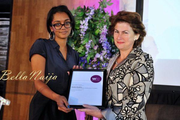 Hadeel Ibrahim receiving the WIE Humanitarian Award from Dame Nicola Brewer