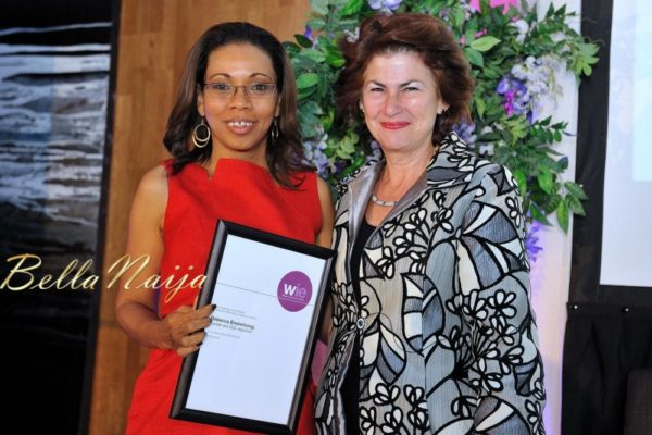 Rebecca Enonchong receiving the WIE 60 Power Influencer Award from Dame Nicola Brewer