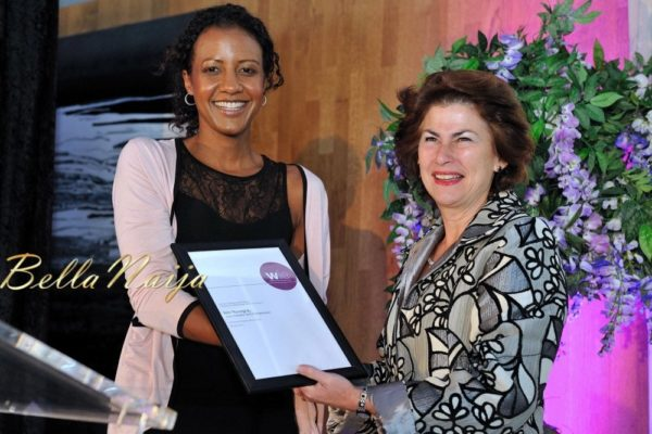 Isis Nyong'o receiving the WIE 60 Power Influencer Award from Dame Nicola Brewer