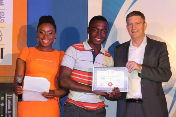 Mr.Arinze Ifeakandu, from University of Nigeria, Nsuka (second left), receiving his certificate of participation from the Managing Director/CEO, Nigerian Breweries Plc, Mr. Nico Vervelde, while the Creative Director, Farafina Trust, Chimamanda Adiche look on at the 2013 Literay Evening by Farafina Trust, sponsored by Nigerian Breweries, held at the Oriental Hotel, Victoria Island, Lagos.