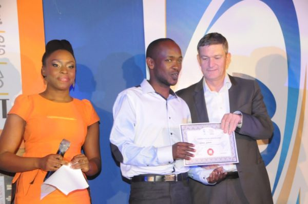 Mr. Kiprop kimutai, from Kenya (second left), receiving his certificate of participation from the Managing Director/CEO, Nigerian Breweries Plc, Mr. Nico Vervelde, while the Creative Director, Farafina Trust, Chimamanda Adiche look on at the 2013 Literay Evening by Farafina Trust, sponsored by Nigerian Breweries, held at the Oriental Hotel, Victoria Island, Lagos.