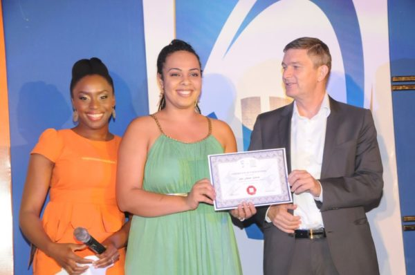 Mrs. Sifa Asani Gowon, from Jos (second left); receiving his certificate of participation from the Managing Director/CEO, Nigerian Breweries Plc, Mr. Nico Vervelde, while the Creative Director, Farafina Trust, Chimamanda Adiche look on at the 2013 Literay Evening by Farafina Trust, sponsored by Nigerian Breweries, held at the Oriental Hotel, Victoria Island, Lagos.