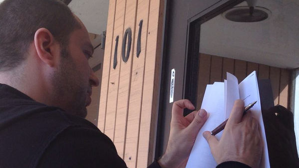 WhatsApp's Jan Koum signing the Facebook deal on the door of his old welfare office