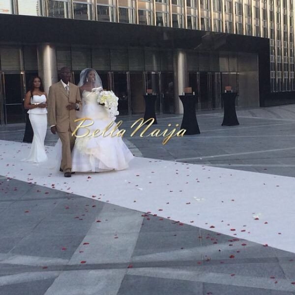 Tiwa & her dad walking down the aisle