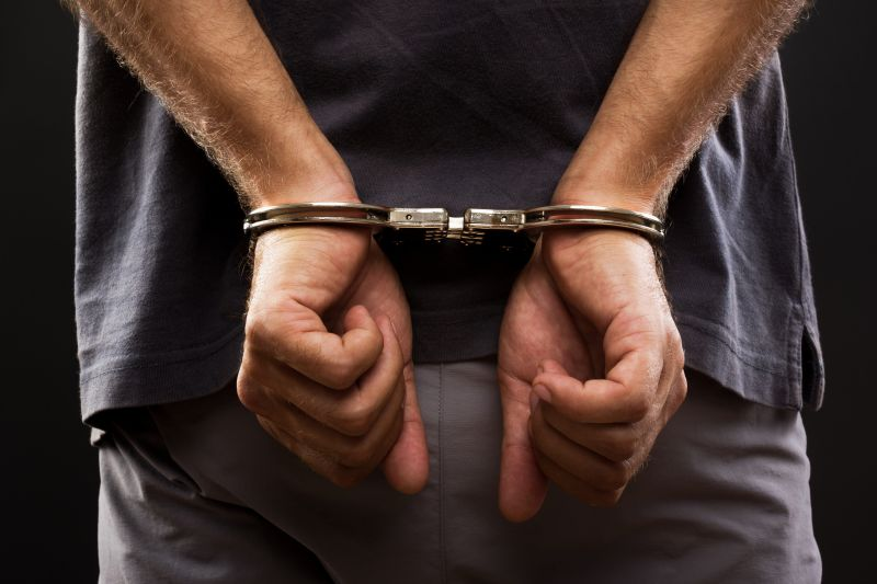 http://www.dreamstime.com/royalty-free-stock-photo-close-up-arrested-man-handcuffed-image26163005