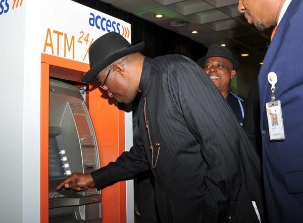 Jonathan unveils E-ID Card- August - 2014 - BellaNaija002