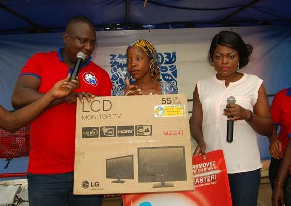 Femi Atoyebi and Funke Akindele giving out a Plasma TV to a lucky winner in Kwara