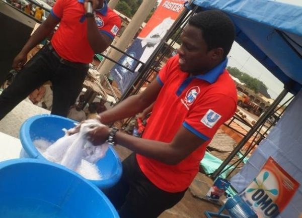 Ali Nuhu demonstrating the fast action power of the new OMO Detergent