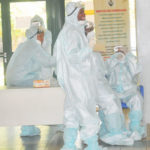 PIC.5. HEALTH PERSONNEL IN PROTECTIVE  KITS IN ABUJA