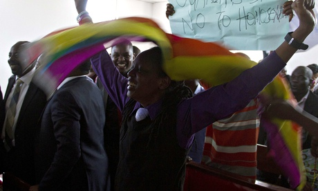 Members of Uganda's gay community reacts as the anti-gay law is declared null and void