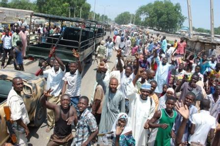 Residents of Konduga cheering the troops
