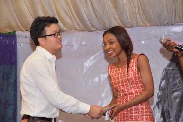 Funke Gina receiving her prize