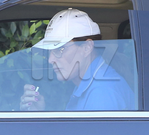 PREMIUM EXCLUSIVE Bruce Jenner paints his nails and smokes a cigarette