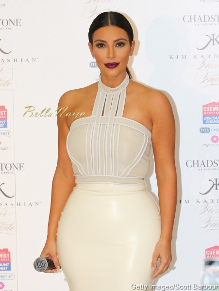 Kim kardashian says she nearly broke her back while posing with a