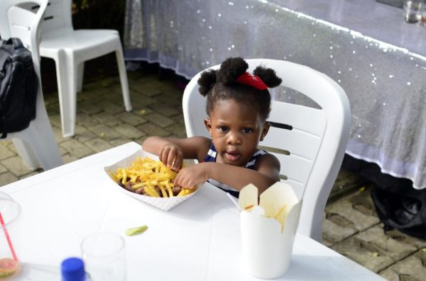 Little Miss Aluko enjoying a meal of cchicken and Chips from Grind Grill Cafe