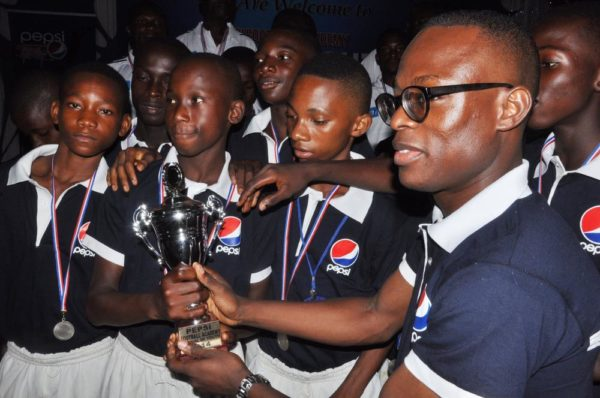 Brand Manager, Seven-Up Bottling Company, Mr. Segun Ogunleye(1st Right) and awardees during the Pepsi Football Academy's  Gala Night in Lagos at the weekend