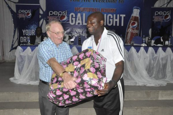 Consultant to Pepsi Football Academy, Mr. Iain Nelson presenting a gift to Mr. Baba Labaran, Coordinator, PFA Kaduna