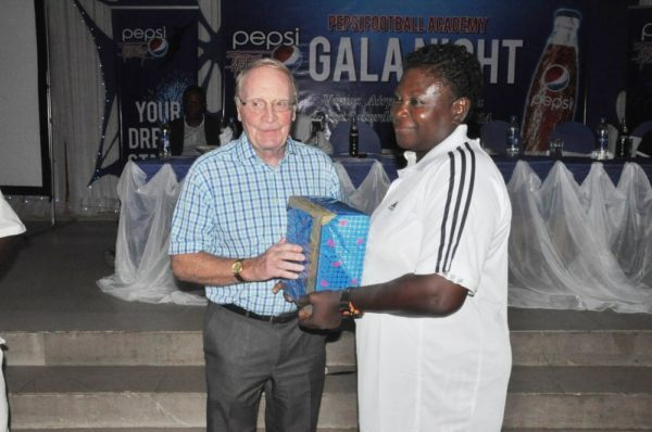 Consultant to Pepsi Football Academy, Mr. Iain Nelson presenting a gift to Mrs. Rachael Enagbare, Coordinator, PFA Benin