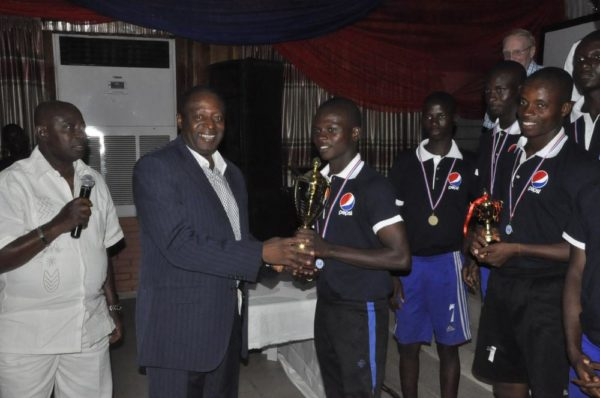 Director, Pepsi Football Academy, Chief Kashimawo Laloko and Technical Director, Nigeria Football Federation (NFF), Mr. Shuaibu Amodu, presenting the trophy to the winning team – PFA North