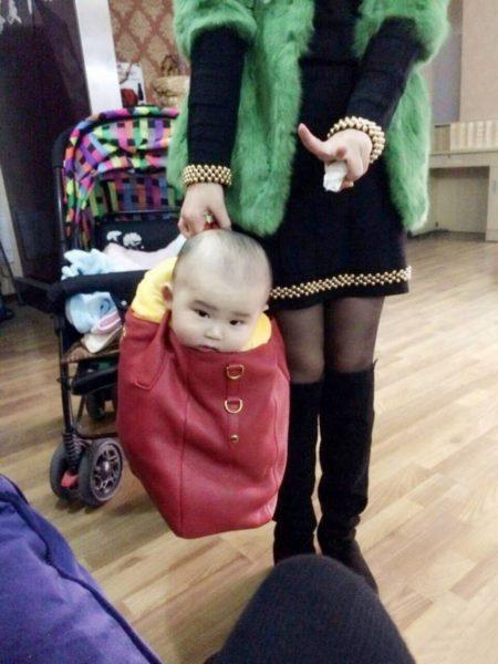 Baby in handbag
