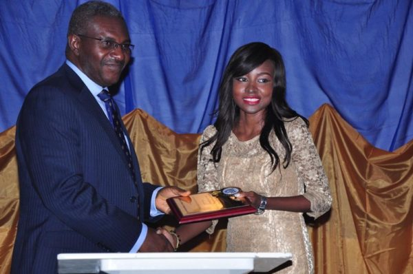Oluwatosin Akingbulu receives her Award from Dr. Mike Okolo, Dean of the School of Media & Communications, Pan Atlantic University