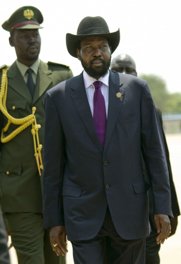 JUBA, SOUTH SUDAN - JULY 9:  South Sudan's first president, Salva Kiir is escorted by security during a ceremony celebrating South Sudan's first Independence day on July 9, 2012 in Juba, South Sudan. After breaking away from Sudan last year, South Sudan is getting ready for its first independence anniversary celebrations. Over the past year repeated conflict with North Sudan, corruption scandals and economic difficulties have plagued the new country. Further problems caused by the shutdown of its oil production have led to a sharp decline in its currency and a rise in the price of food and fuel. (Photo by Paula Bronstein/Getty Images)