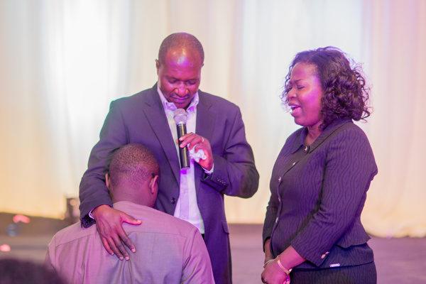 Medua Jideonwo praying for Chude Jideonwo