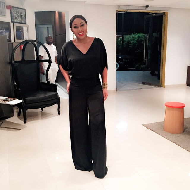 Rita Dominic in a black jumpsuit at the launch of Emmaus Skincare