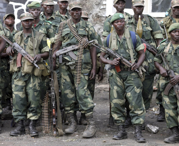 Government army FARDC soldiers stand in a line at an army barrack as they return to Goma