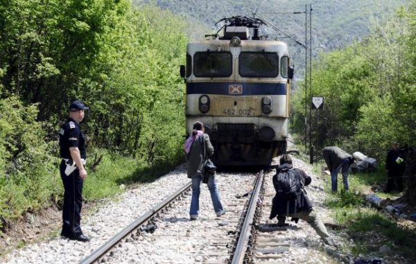 Media and police inspect at the scene where fourteen migrants were hit by a train, near Veles  April 24, 2015.  REUTERS/Ognen Teofilovski